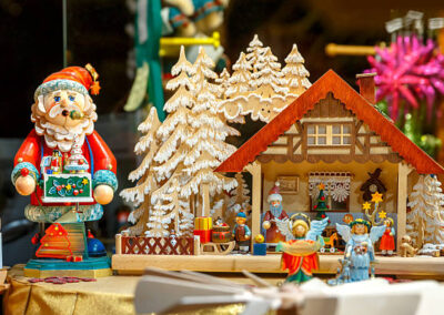 Santa Claus and wooden house at a Christmas souvenir  market shop, decorated and illuminated in Bruges, Belgium