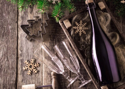 Christmas and New Year celebration with champagne. New Year holiday decorated table. Two Champagne Glasses on wooden table